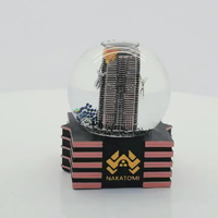 Resin brand building souvenirs musical Custom snow globe with blowing snow